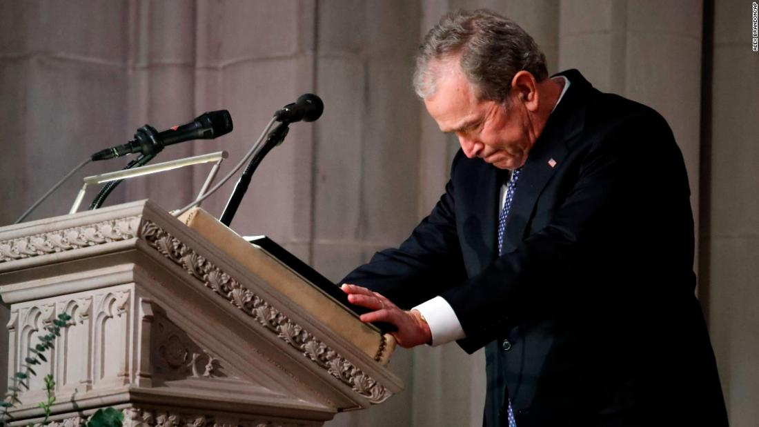 "Former US President George W. Bush speaks at the state funeral of his father, former US President George H.W. Bush, on Wednesday, December 5. ""He showed me what it means to be a President who serves with integrity, leads with courage and acts with love in his heart for the citizens of our country,"" Bush said in his eulogy."