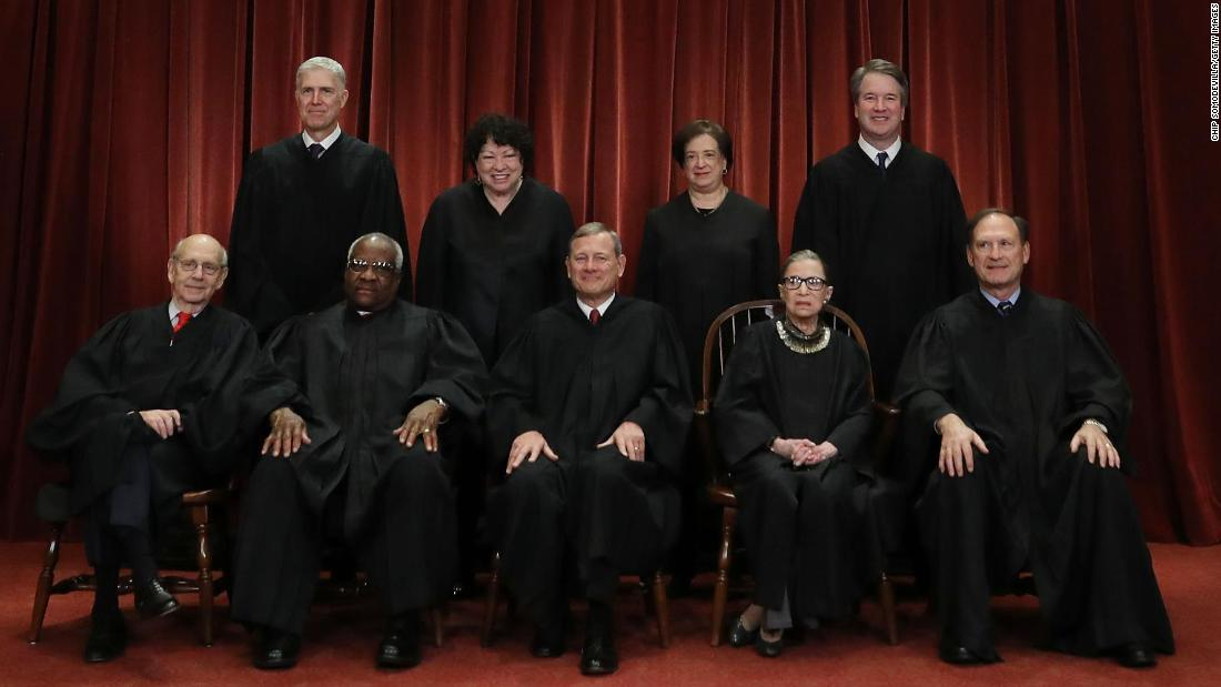 The US Supreme Court, with newest member Brett Kavanaugh, poses for an official portrait in Washington on Friday, November 30. In the back row, from left, are Neil Gorsuch, Sonia Sotomayor, Elena Kagan and Kavanaugh.