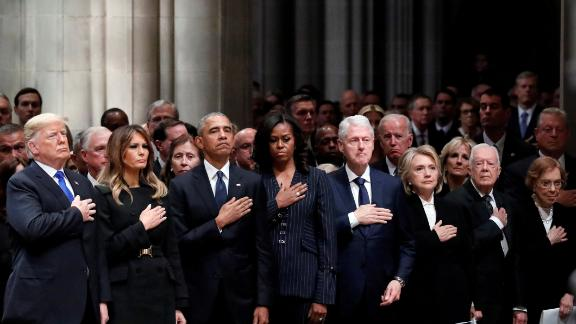 """Donald and Melania Trump join former US Presidents and their wives at <a href=""""https://www.cnn.com/2018/12/02/politics/gallery/george-h-w-bush-memorials/index.html"""" target=""""_blank"""">the state funeral of George H.W. Bush</a> in December 2018. In the front row, from left, are the Trumps, Barack and Michelle Obama, Bill and Hillary Clinton, and Jimmy and Rosalynn Carter."""