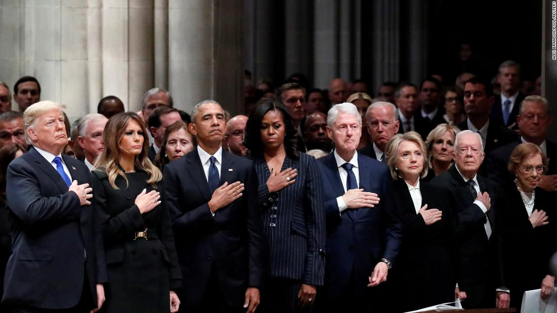 US President Donald Trump and his wife, Melania, join former US Presidents and their wives at the state funeral of George H.W. Bush on Wednesday, December 5. In the front row, from left, are the Trumps, Barack and Michelle Obama, Bill and Hillary Clinton, and Jimmy and Rosalynn Carter.
