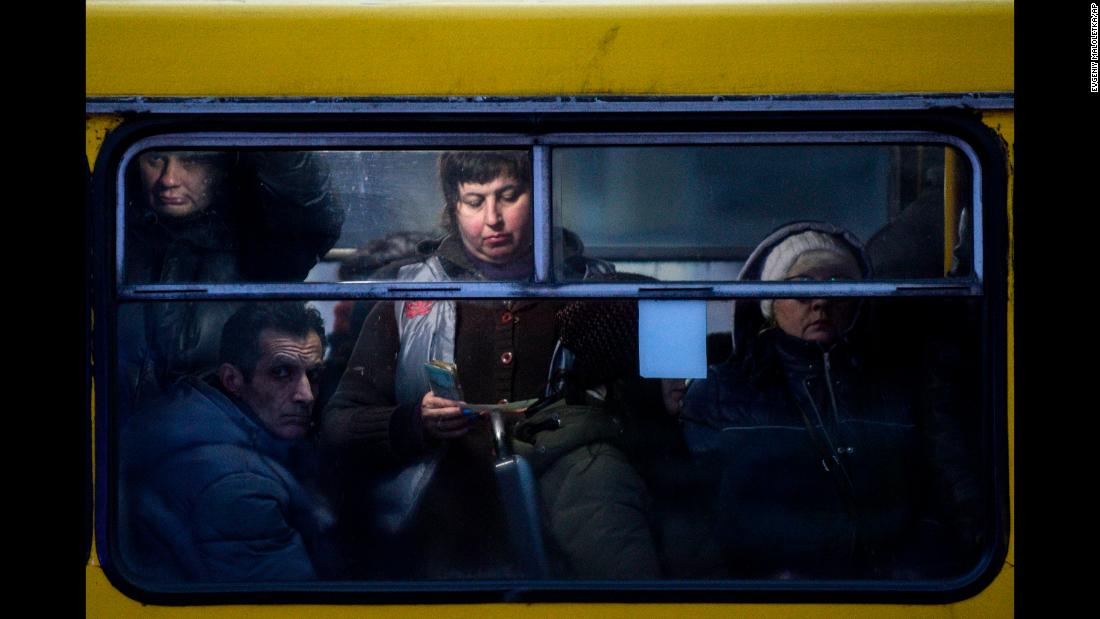 People ride a bus in Mariupol, Ukraine, on Friday, November 30.