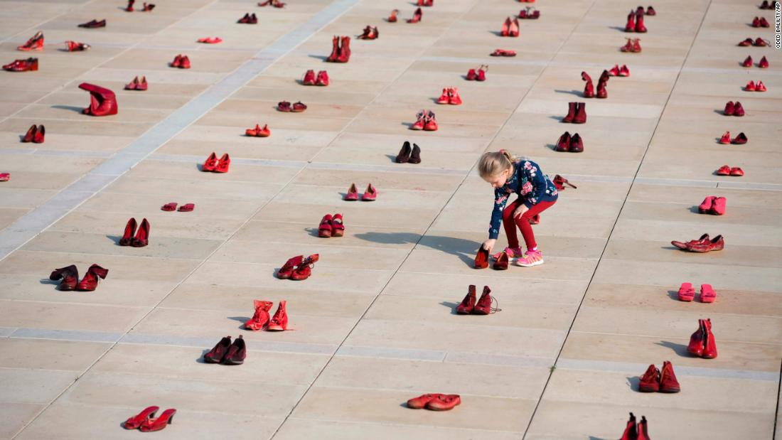 Hundreds of red shoes were displayed in Tel Aviv, Israel, on Tuesday, December 4, as part of a protest against violence toward women.