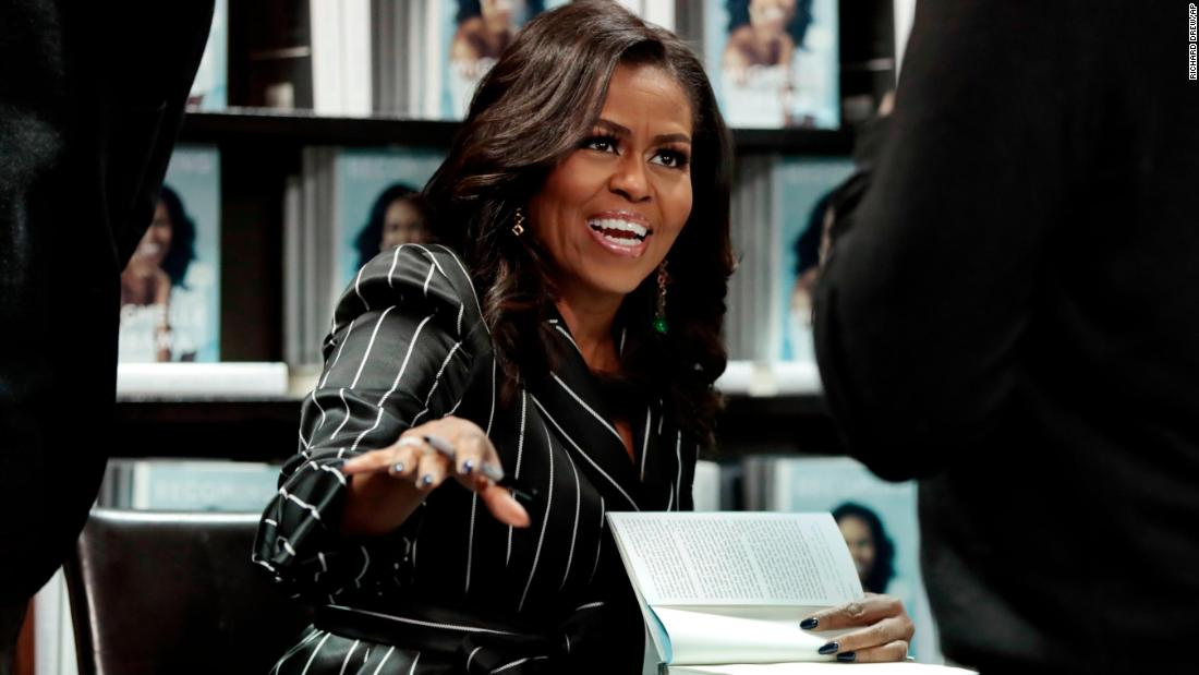 "Former first lady Michelle Obama signs books in New York during a promotional appearance for her memoir, ""Becoming,"" on Friday, November 30. It has become the best-selling book in the country for 2018."