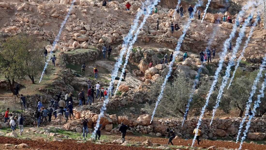 Tear gas canisters are fired by Israeli troops toward Palestinians during a demonstration in the West Bank on Friday, November 30. The Palestinians were protesting Israeli land seizures for Jewish settlements.