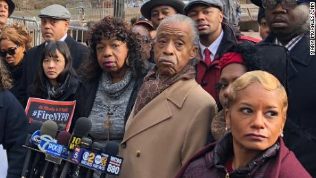 Eric Garner's mother, Gwen Carr, center, with the Rev. Al Sharpton and others after a disciplinary hearing for Daniel Pantaleo.