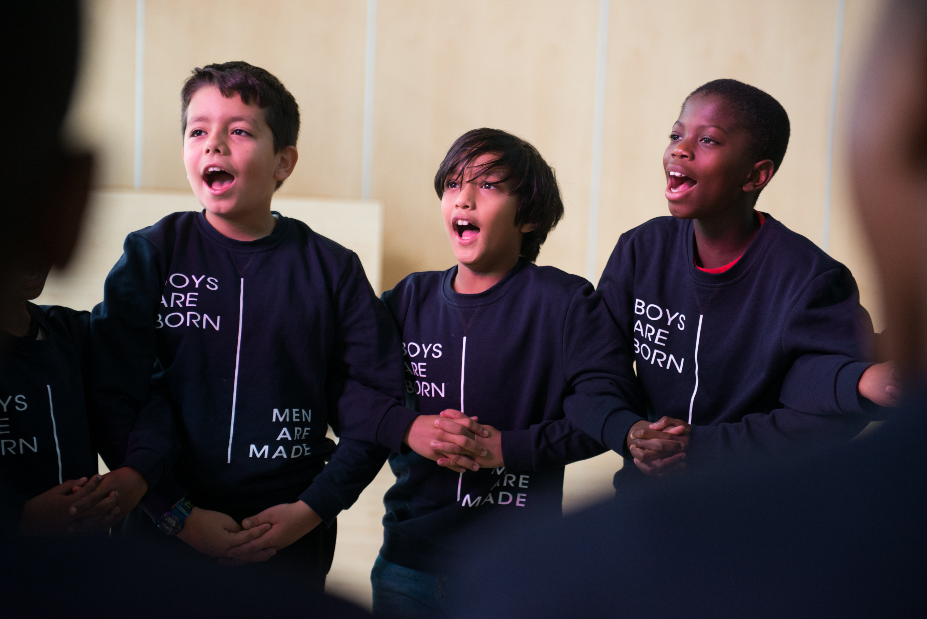 "Manhood Academy boys chant the program's mantra, ""Boys are born! Men are made!"" at the beginning of a session in October."