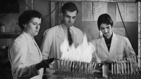 Researchers test cigarette filters with a smoking machine.