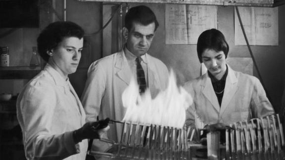 Scientists test cigarette filters with a smoking machine.