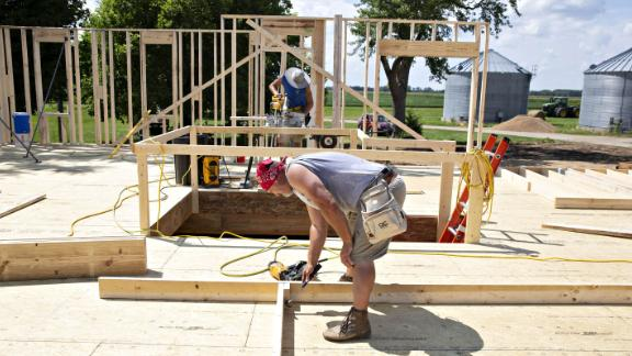 Contractors build wall frames during construction of a new Doug Phillips Construction Inc. home in Walnut, Illinois, U.S., on Wednesday, Aug. 1, 2018. The U.S. Census Bureau is scheduled to release housing starts figures on August 16. Photographer: Daniel Acker/Bloomberg via Getty Images