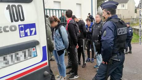 Police detain students Thursday in Mantes-la-Jolie after clashes with security forces.
