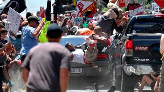 """Pedestrians fly into the air after James Fields drives into a crowd of people protesting against the """"Unite the Right"""" white nationalist rally in August 2017."""