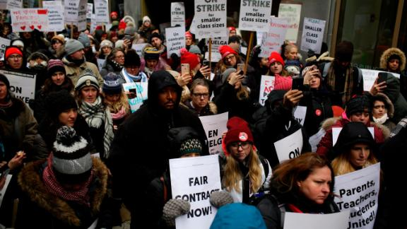 CHICAGO, IL - DECEMBER 05: Educators from the Acero charter school network hold signs as they protest during a strike outside Chicago Public Schools headquarters on December 5, 2018 in Chicago, Illinois. Teachers are asking for smaller class sizes, fair pay and better resources to continue teaching more than 7,000 students, who attend Acero charter schools network. (Photo by Joshua Lott/Getty Images)