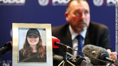 Detective Scott Beard speaks to the media next to a photo of  Grace Millane in Auckland, New Zealand.