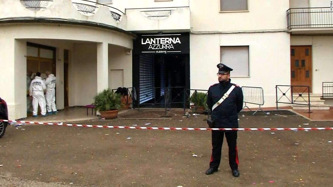 Forensic teams and police cordon off the Lanterna Azzurra club's entrance Saturday in Corinaldo.