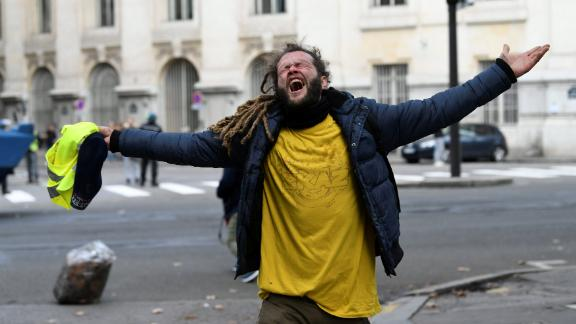 A protester reacts during clashes with police on December 8 in Paris.