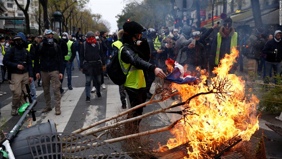 Protesters install a barricade during clashes with police at a demonstration in Paris on December 8.
