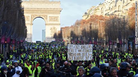 Protesters gather near the Arc de Triomphe Saturday in the French capital.