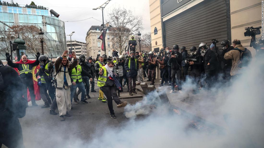 France's 'yellow vest' protesters detained and tear-gassed