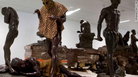 Belgian colonial museum re-opens amid protests and demands for return of artifacts