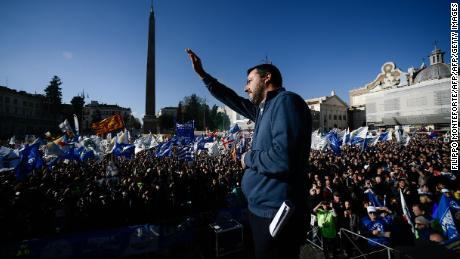Matteo Salvini waves to around 50,000 supporters at the Rome rally.