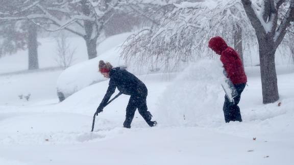A couple shovels their driveway in Greensboro, N.C., Sunday, Dec. 9, 2018. A massive storm brought snow, sleet, and freezing rain across a wide swath of the South on Sunday - causing dangerously icy roads, immobilizing snowfalls and power losses to hundreds of thousands of people.