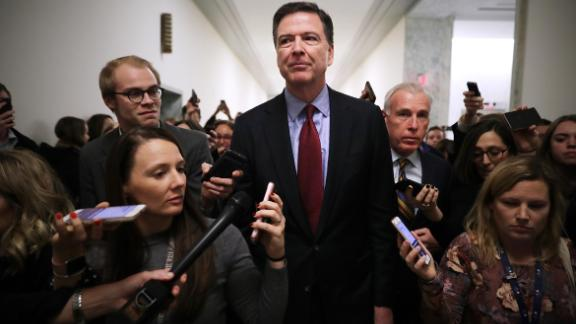 Former Federal Bureau of Investigation Director James Comey is surrounded by reporters after testifying to the House Judiciary and Oversight and Government Reform committees at the Rayburn House Office Building on Capitol Hill December 07, 2018 in Washington, DC.