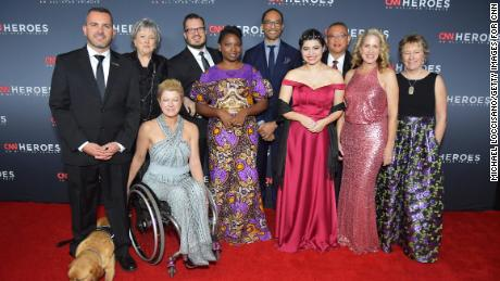 NEW YORK, NY - DECEMBER 09:  (L-R) 2018 Top 10 CNN Heroes Chris Stout, Florence Phillips, Amanda Boxtel, Luke Mickelson, Abisoye Ajayi-Akinfolarin, Maria Rose Belding, Dr. Ricardo Pun-Chong, Susan Munsey, and Ellen Stackable attend the 12th Annual CNN Heroes: An All-Star Tribute at American Museum of Natural History on December 9, 2018 in New York City.  (Photo by Michael Loccisano/Getty Images for CNN )