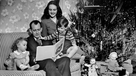 UNITED STATES - CIRCA 1950s:  Family w Christmas tree at home.  (Photo by George Marks/Retrofile/Getty Images)