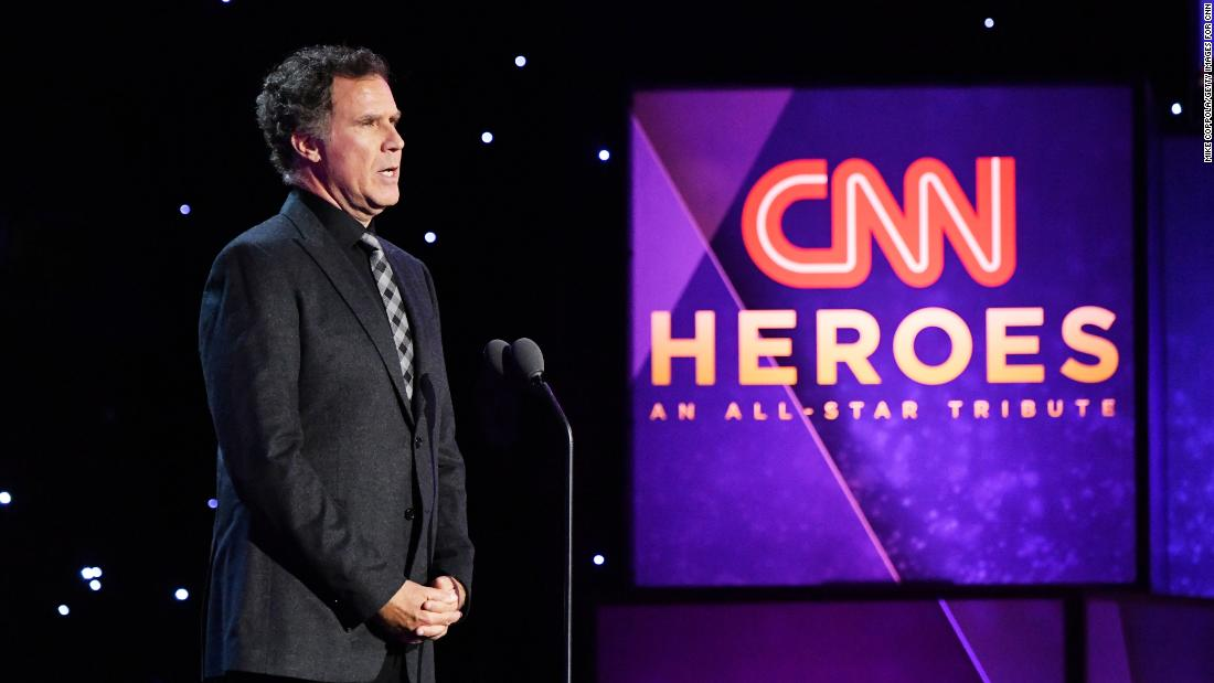 Comedian Will Ferrell presents an award to Top 10 CNN Hero Maria Rose Belding.