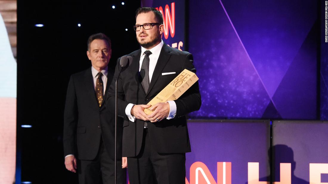 "Top 10 CNN Hero Luke Mickelson accepts his award from actor Bryan Cranston, left, onstage during the 12th annual ""CNN Heroes: An All-Star Tribute."""