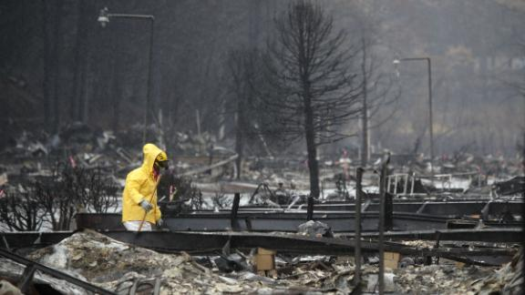 A search and rescue crew member searches for human remains at a mobile home park in Paradise which was destroyed on November 21, 2018.