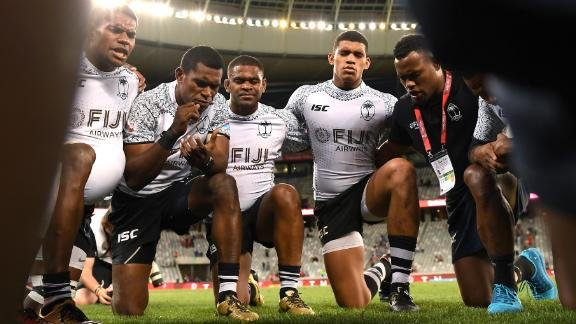 Fijian players huddle after defeating USA to record their first win of the season in Cape Town.