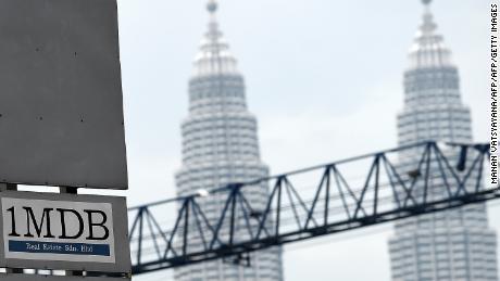 Malaysia's Twin Towers set the scene for the 1Malaysia Development Berhad (1MDB) logo on a billboard.
