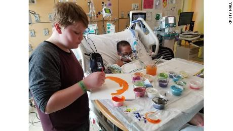 Kaleb Klakulak, 12, paints with K.J. in the hospital.