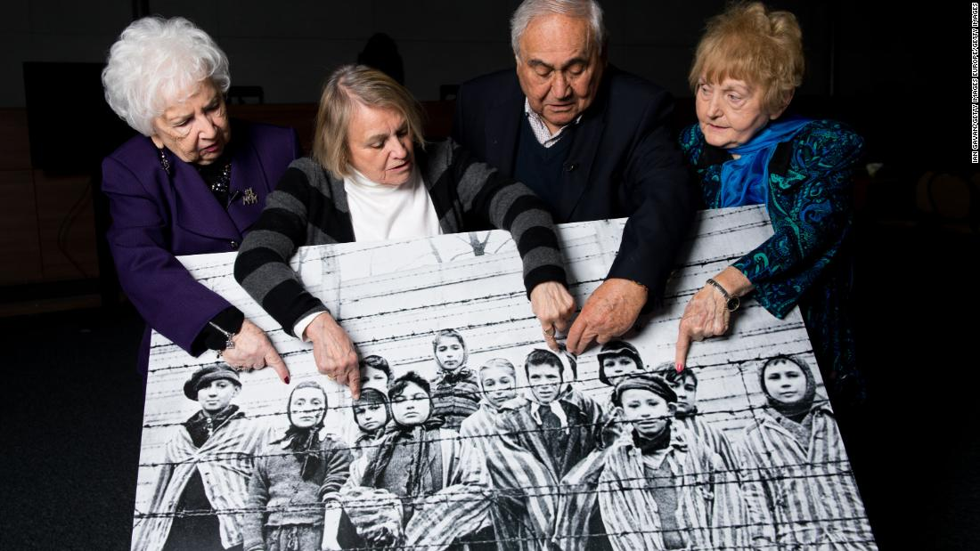 Far right: Eva Kor in 2015 points at an image of herself as a child taken during the liberation of Auschwitz, along with other survivors.