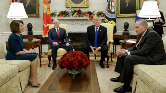President Donald Trump and Vice President Mike Pence, meet with Senate Minority Leader Chuck Schumer, D-N.Y., and House Minority Leader Nancy Pelosi, D-Calif., in the Oval Office of the White House, Tuesday, Dec. 11, 2018, in Washington. (AP Photo/Evan Vucci)