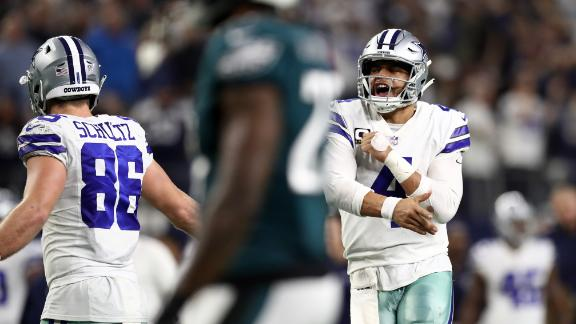 Dak Prescott of the Dallas Cowboys celebrates a touchdown pass against the Philadelphia Eagles in the fourth quarter at AT&T Stadium on December 09, 2018 in Arlington, Texas.