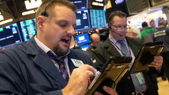Trader Michel Milano works at the New York Stock Exchange, Tuesday, Dec. 11, 2018, in New York. Stock markets around the world spiked higher Tuesday after Wall Street rebounded amid hopes the U.S. and China are back negotiating over their trade dispute. (AP Photo/Mark Lennihan)