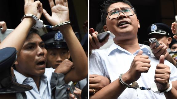 (COMBO) This combo shows journalists Kyaw Soe Oo (L) and Wa Lone (R) being escorted by police after their sentencing by a court to jail in Yangon on September 3, 2018. - Two Reuters journalists were jailed on September 3 for seven years for breaching Myanmar's official secrets act during their reporting of the Rohingya crisis, a judge said, a case that has drawn outrage as an attack on media freedom. (Photo by Ye Aung THU / AFP)        (Photo credit should read YE AUNG THU/AFP/Getty Images)