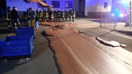 Choc-a-block: Liquid chocolate leak envelops German street.