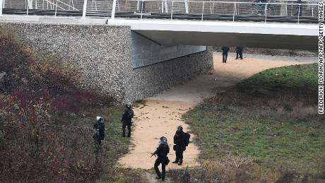 French special forces  search a bank of the River Rhine in Strasbourg on Wednesday as they hunt the gunman.