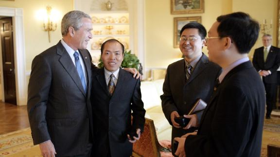 President George W. Bush meets with Chinese Human Rights activists Li Baiguang,  Wang Yi, and Yu Jie in the Yellow Oval Room of the White House in Washington, DC on May 11, 2006. (Photo by Eric Draper/WireImage)