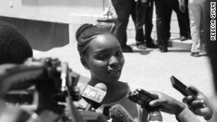 Rebeca Gyumi speaks to reporters after opening the case to challenge the Law of Marriage Act in 2016.