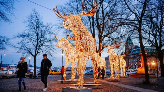 Thousands of lights decorate moose statues in Stockholm on December 16, 2014. Stockholm has lit over 700,000 Christmas lights around the city where 35 streets, squares and marketplaces glistens and glimmers of Santas, moose, stars and other decorations that make the dark season brighter for the Christmas season. AFP PHOTO/JONATHAN NACKSTRAND        (Photo credit should read JONATHAN NACKSTRAND/AFP/Getty Images)