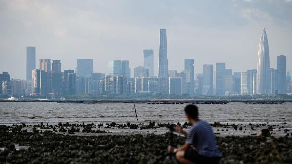 A man looks across Deep Bay towards the Chinese mainland city of Shenzhen's (back) skyline from Hong Kong on September 12, 2018, in this file photo.