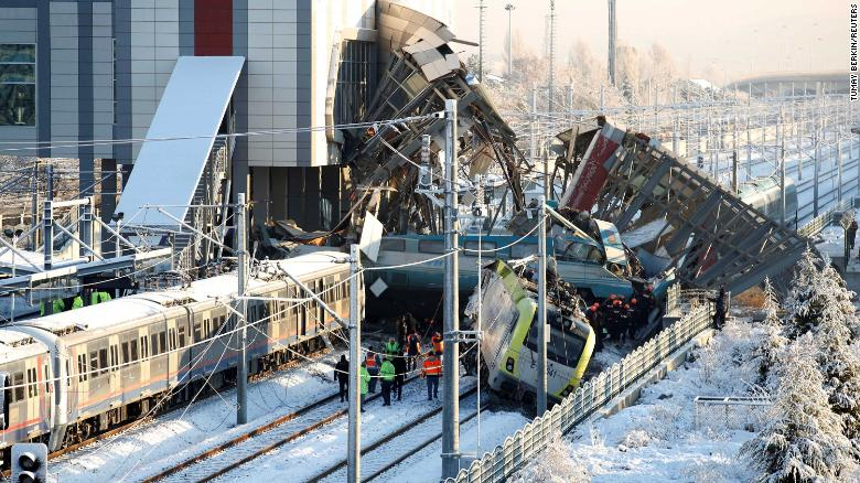 Rescue workers search through wreckage after a high-speed train crash Thursday in Ankara, Turkey.
