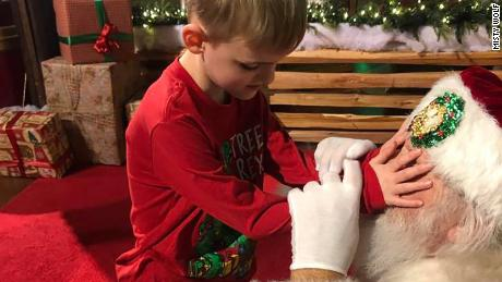 Matthew Wolf is blind and has autism, so the Santa Claus let him feel his face.