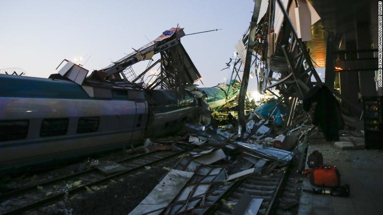 Rescuers evacuate injured passengers after the high-speed train crash Thursday.