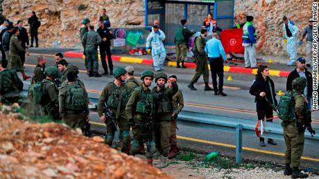 Israeli forces at the site of a drive-by shooting attack near Ramallah on Thursday.