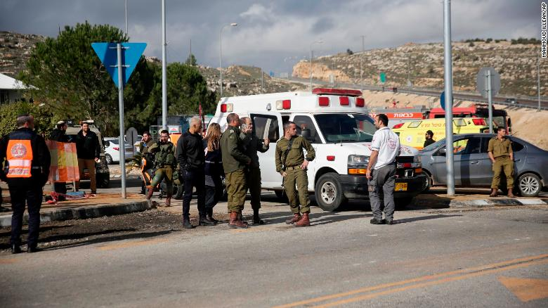 Israeli soldiers stand at the scene of an attack near the settlement of Givat Assaf in the West Bank on Thursday.